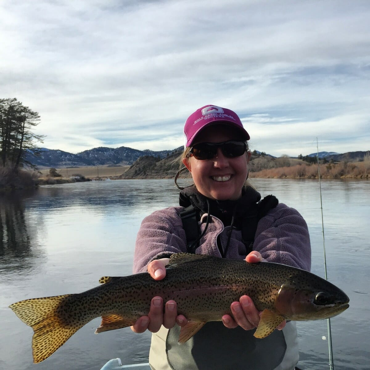 Wolf Creek Angler guide Luke Koerten with a bright and feisy 5 O'Clock bow. - photo Wolf Creek Angler, LLC